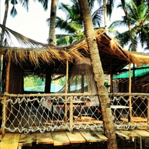 View of a balcony overlooking the sea from the Deluxe huts at Cozy Nooks