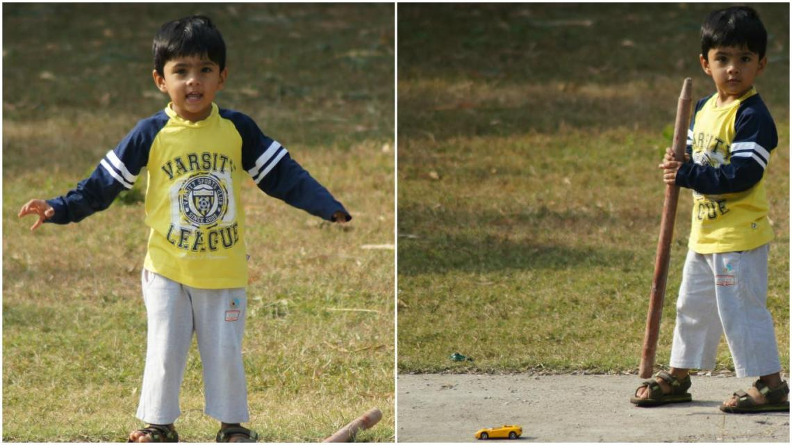 Our Son enjoying a game of cricket and some running around in the wide garden ground.