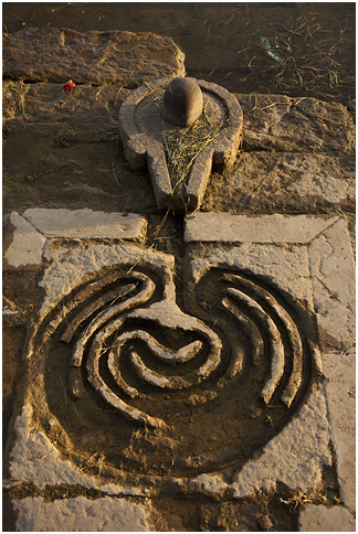 A Shiva Lingam seen at a Ghat with an interesting spiral maze for water channel Image @ Nevil Zaveri, Flickr